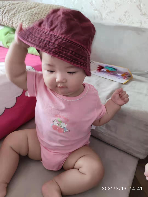 带着姐姐的帽子